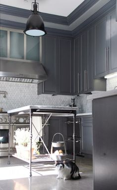 Make your own kitchen island with black gas pipe and i love that penny tile in the backsplash!