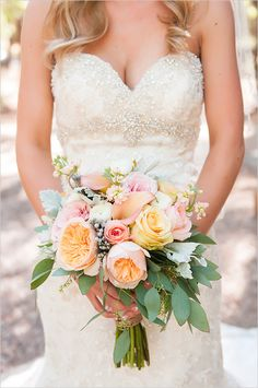 peach and pink bouquet with leafy greens
