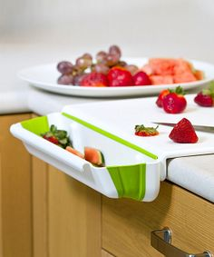Collapsible Bin Cutting Board -  An attached dish catches chopped food for speedier slicing and dicing, while collapsible technology provides a compact storage solution.