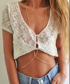 Such a cute look. Low slung jean shorts, cropped lace top and a body chain... You need to have THIS body to pull it off - but still. jean shorts, fashion, style, crop tops, bodi chain, beach jewelry, necklaces, denim shorts, body chains