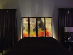 Custom image room divider screen used as headboard with accent lighting behind it.  Memories are bigger than ever now