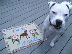 Eldad posing next to the custom doormat our friend & talented artist Mady Ayende sent!