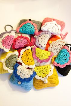 Sweet crochet wallet (coin purse) with inner lining and hand strap. $15.95, via Etsy.    Finally found the probable source to a very cute little purse!  These would make cute party favors at birthday parties!