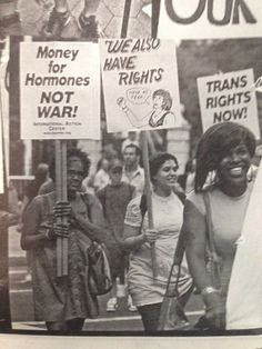 """[Black and white picture of Black Trans women protesting, carrying signs that say """"Money for hormones, not war!"""" """"We also have rights!"""" and """"Trans Rights Now!""""]"""