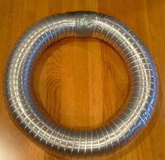 Dryer Vent Ducting & Duct tape make nice HUGE lightweight wreath form.  From MrsPollyRogers.com