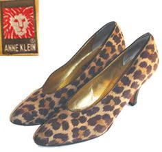 Vintage 80s, Anne Klein suede shoes with a ferocious leopard print.   These high heel beauties have a brown leather trim at top line and leather outer soles.  Shoes have been gently worn.  Insole stamped Anne Klein, outer soles Made in Italy.