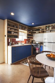 I like the blue (Ply cabinetry, block colour laminate matched to ceiling)