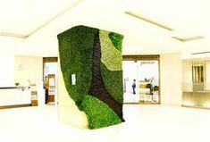 Green walls and living sculptures in Shinjuku's Isetan department store...