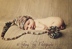 Newborn baby portrait #session with a long tail knit pom pom hat #photo prop #poses #inspiration #photography