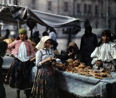 ca. January 1930, Mohacs, Hungary --- Peasant women sell bread at the market --- Image by © Hans Hildenbrand/National Geographic Society/Corbis