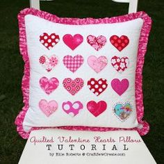 Quilted Valentine Hearts Pillow tutorial by Ellie from Craft Sew Create. These simple quilted toss pillows are made with rows of Valentine's Day appliques on a plain, quilted background