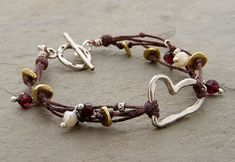 Multiple Strands and Silver Heart Bracelet