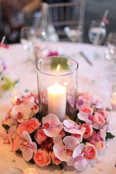 candle centerpiece with orchids