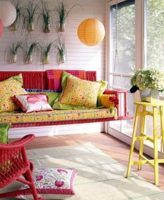 Bright painted stool as plant stand or side table.  Also the paper lanterns for the porch and love the colorful swing.
