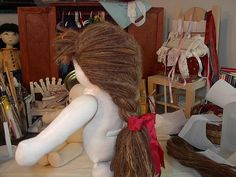 Flickr tutorial for doll hair using a crocheted wig cap.