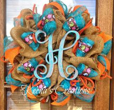 Rich with color, this paper mesh wreath with wooden monogram features a natural paper mesh base decorated with turquoise banana-weave ribbon, brown Owl ribbon, orange burlap ribbon and orange jute tubing. The gorgeous H vine monogram is hand-painted with a crackle finish of orange and turquoise. Mesh, ribbon, jute tubing and base wreath purchased at http://www.trendytree.com.  See more of my wreaths at http://www.facebook.com/keenascreations #trendytree #wreath