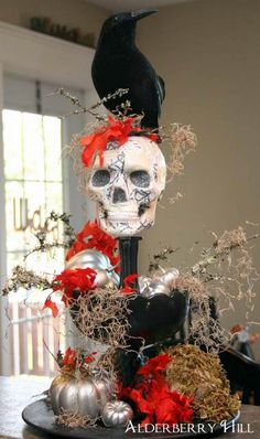 Inspired by the creativity of this Ghoulish Centerpiece. May have to start thinking out of the decorating box.
