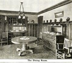 """Sears must have been very proud of their Ashmore, too. For more than a dozen years, interior """"views"""" of the Ashmore were featured in two-page spreads. Only the more impressive houses were given two full pages in the old catalogs. The dining room (shown above) is outfitted with classic Arts & Crafts pieces. The oak wainscoting (topped with plate-rail) is shown, but not the coffered (beamed) ceiling."""