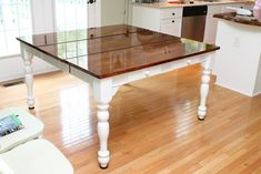high gloss varnish refinished wood table (we need to refinish ours again..)