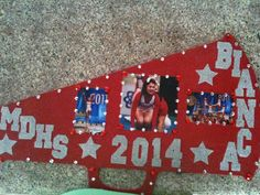 @mrsevanbarnes super Cute Mega phone wood cut out, add letters and number cut out from cricut, add picture, modge podge, and rhinestones. Can use as wall decoration and/or take for team support at your next competition