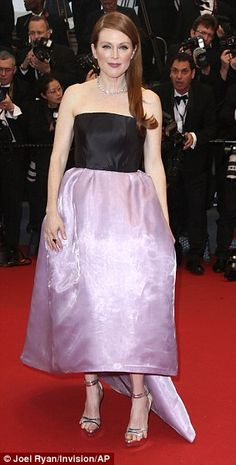 Actress Julianne Moore, arriving for the Cannes Opening Ceremony, looked ravishing in a Dior gown, but her feet less so