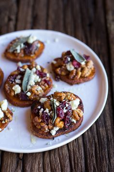{Curried sweet potato rounds with honeyed walnuts, cranberries and blue cheese.}