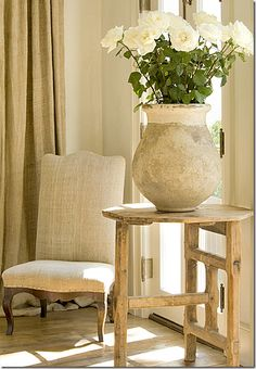 While most high end designers use French olive jars, large and small, their price is out of the reach of many.  Instead, substitute white ironstone in place of the antique olive jars.   Ironstone, vintage and antique, is very price friendly.