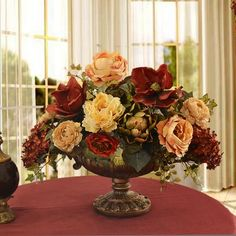 "Burgundy and Cream Grande Silk Floral Centerpiece AR339. This elegant silk floral arrangement in dep contrasting colo makes a statement with its grande size. Created with quality magnolias, oopen roses, artihoke and cone hydrangeas. Measures 17"" H x 20"" W  #silkflowers #silkflowerarrangements"