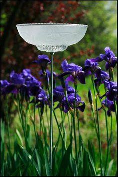bird feeder or birdbath from old frosted glass light fixture @ dishfunctionaldesigns.blogspot.com