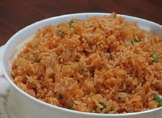 Mexican Rice @ Mexican Recipe Box  // Could easily substitute vegetable stock for the chicken stock.