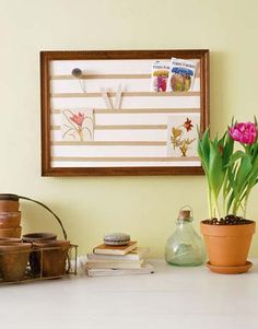 Pocket Board  Transform a flea-market picture frame into a pretty — and practical — pocket organizer with some mat board. Once suspended, the wall display lets you show off favorite photographs, postcards, or notes.