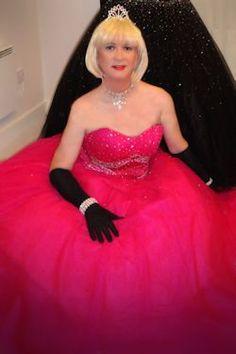 Transvestite in a beautiful pink ballgown