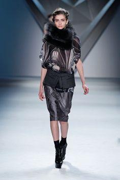 Black vault print silk chiffon high neck cape top with oversized charcoal raccoon neck gator over steel vault jacquard skirt with charcoal melton zip-front peplum.