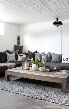 White/grey living room with wooden details. And a lovely lantern!