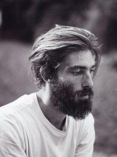 white tee. beard.