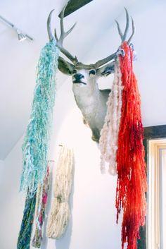 my yarn hangs in Lexi's studio!