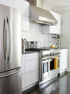 Glossy white cabinets can make your kitchen feel modern and bright! For more tricks using white cabinets: http://www.bhg.com/kitchen/cabinets/styles/kitchen-cabinets-in-white/?socsrc=bhgpin090613highglosscabinets=9