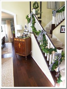 love the idea of using black and white at christmas stair, christma decor, white christmas, ribbon bows, black white, holiday idea, big bows, christmas garlands, holiday decor