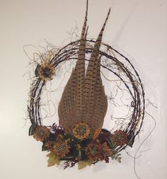 Barb wire & rope wreath with pheasant feathers...