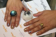 Gorgeous labradorite on one hand, warm citrine on the other.  Both rings from Greenwich Jewelers, nail art by Sally Hansen.