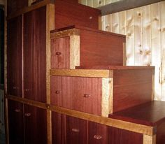 Face, side and back panels of lyptus solids; rift-sawn oak frames (two sections); belts bought at Burlington Coat Factory, cut, looped and glued into mortises. Top step is lift-up lid for storage