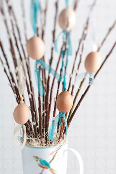 Ordinary brown eggs are transformed into stunning ornaments for this whimsical Easter centerpiece from Taste of Home -Nice