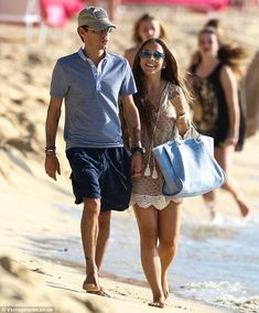 Chloe Green and Marc Anthony seemed to be positively giddy at the prospect of what lies in store for them throughout 2014 as they stepped out on a romantic beach walk in Barbados on Wednesday afternoon.  The 22-year-old Topshop heiress and her 45-year-old beau - who are holidaying in the Caribbean with Chloe's family - looked more in love than ever as they erupted into a fit of giggles while walking hand-in-hand down the pristine white sands together.