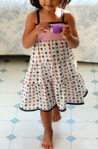 This Tiered Girl's Dress Pattern will look stunning on your daughter or granddaughter. The long layers and adorable little tank top make it the perfect dress for summer. It doesnt matter if you are looking for something for her to sport on the playground or sit still in at church, this free dress pattern easily fits an occasion with the right fabric.
