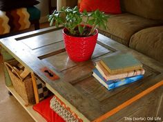 By adding casters and a bottom shelf area, this salvaged door was turned into an amazing living room accessory.