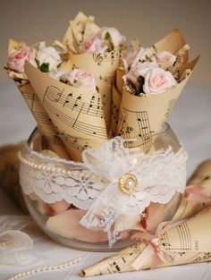 Vintage Music Sheet Rose Cones table decoration.  Great Idea for simple chic decoration!