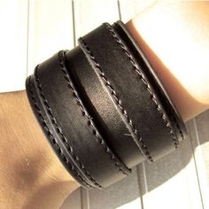 Black bracelet with two metal buckles