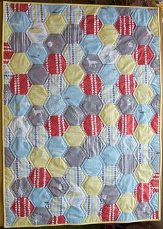 I just started cutting out hexs for this quilt!!  Storyboek Hexagon Quilt   by villagehaberdashery