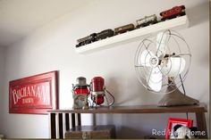 Another picture of the room decorated for a baby boy (family name Buchanan on the sign painted by Red Hen Home) railroad theme for the room is adorable with vintage items