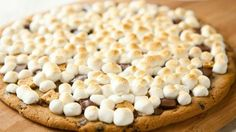 Grilled Chocolate Chip S'more Pizza - 1 package (16 oz) Pillsbury® Ready to Bake!™ refrigerated chocolate chip cookies, 1/2 cup small pieces graham crackers, 1/2 cup small pieces milk chocolate candy bars, 2 cups miniature marshmallows..